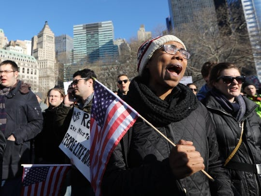 Karen Ash of Brooklyn says her parents are immigrants from St. Vincent and that she came to Battery Park on Sunday to show her support for immigrants.