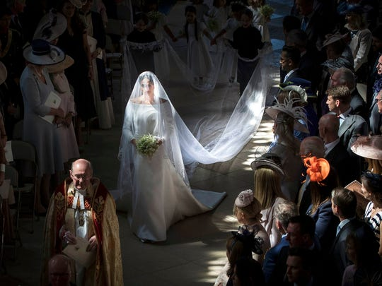 Meghan Markle walks down the aisle as she arrives for the wedding ceremony of Prince Harry and Meghan Markle at St. George's Chapel in Windsor Castle in Windsor, near London, England, Saturday, May 19, 2018. (Danny Lawson/pool photo via AP)