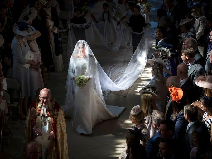 Meghan Markle walks down the aisle as she arrives for