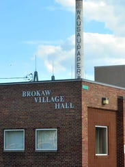 Brokaw's village hall in front of the old paper mill