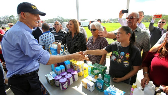 Florida Gov. Rick Scott thanks volunteers who are assisting with the relief effort for Puerto Rico in the wake of Hurricane Maria.