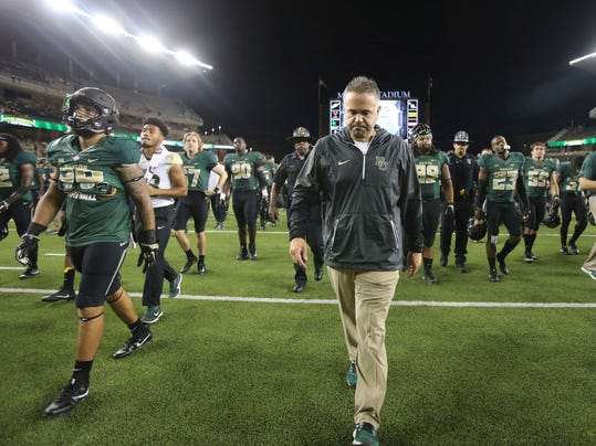 FILE - In this Sept. 9, 2017, file photo, Baylor coach Matt Rhule walks off the field following the team's 17-10 loss to UTSA in an NCAA college football game, in Waco, Texas. Rhule never expected his job at Baylor to be easy, Tom Herman took over a Texas program with plenty of ups and downs since being the league's last national champ 12 seasons ago, and Lincoln Riley suddenly was leading the 10-time league champ with a Heisman Trophy-caliber quarterback. The results so far clearly reflect the situations inherited by the Big 12's three new head coaches. (Jerry Larson/Waco Tribune Herald, via AP, File)