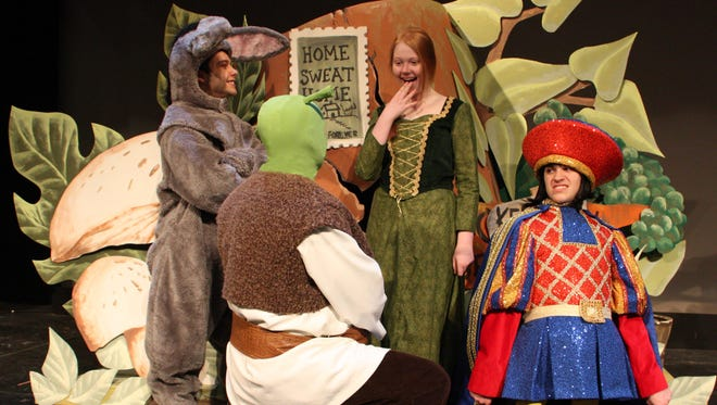 "Starring in the Johnson City High School production of ""Shrek the Musical"" are, from left, Christopher Bunt (Donkey), Jeremy Burdick (Shrek), Emily Bors (Fiona) and R.J. Fox (Lord Farquaad)."