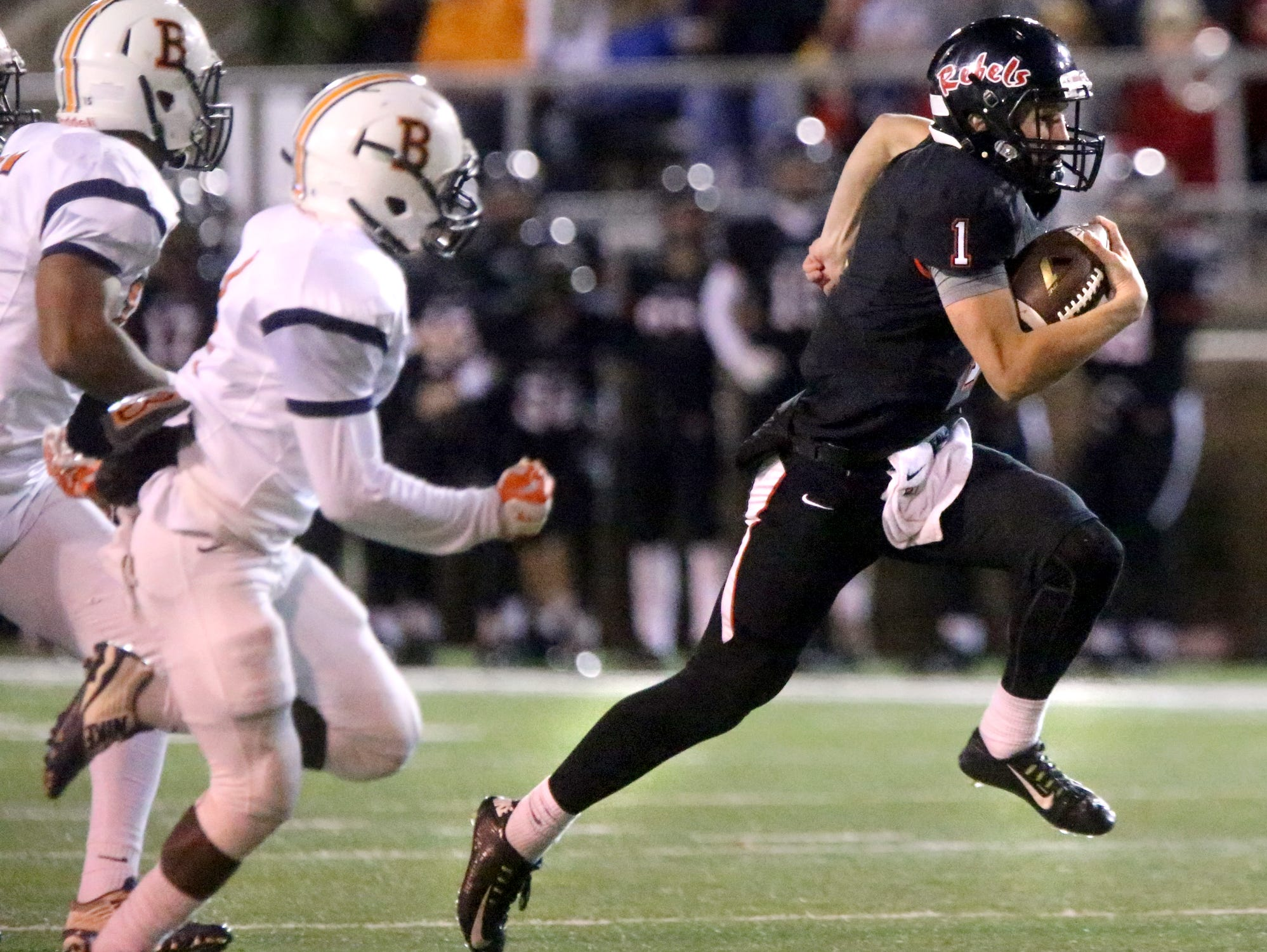 Maryville's quarterback Dylan Hopkins (1) runs the ball during the quarterfinal game against Blackman, at Maryville, on Friday, Nov. 20, 2015.