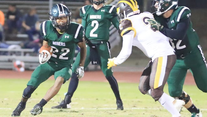 El Diamante's Devontae Freeman (22) attempts to cut inside of Golden West's defender Frankie Gonzales (2) during the 14th annual Battle of the Saddle high school football game at Visalia Community Stadium on Nov 3rd, 2017