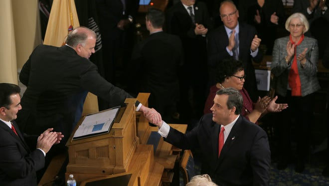 NJ Governor Chris Christie (right) greets Senate President Stephen Sweeney and Assembly speaker Vincent Prieto as he arrives in the Assembly Chamber at the Statehouse in Trenton Tuesday, January 12, 2016, to deliver his State of the State address.