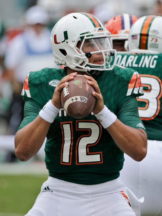 File-This Oct. 24, 2015, file photo shows Miami quarterback Malik Rosier (12) looking for an open receiver  during the first half of an NCAA College football game Miami Gardens, Fla. Rosier was announced Tuesday as No. 18 Miami's new starting quarterback, winning the right to take over for record-setting three-year starter Brad Kaaya under center for the Hurricanes. He beat Evan Shirreffs and N'Kosi Perry for the job, and threw for team-highs of 441 yards and five touchdowns in Miami's two camp scrimmages.(AP Photo/Wilfredo Lee, File)