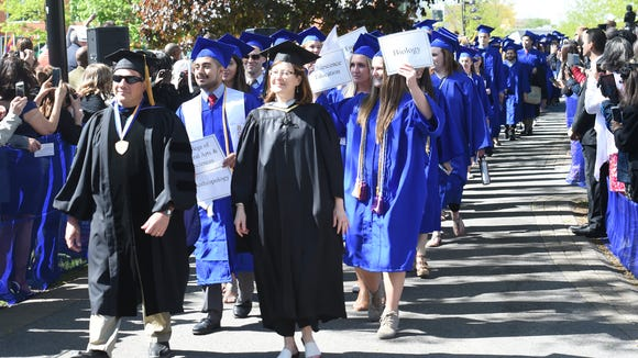 Candidates for graduation walk in for SUNY New Paltz's 2016 commencement ceremony in this file photo from May.