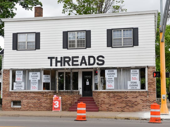Threads Boutique is a recognized landmark at the corner