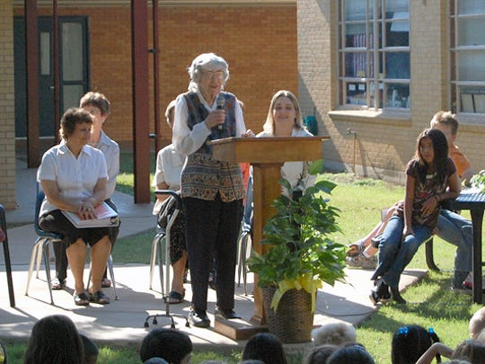 Mrs. Howell speaks at the dedication of the Marjorie Howell Library at Crockett Elementary School.
