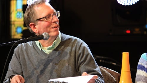 """Phil Cianciola takes part in a rehearsal for the live radio production of """"It's a Wonderful Life"""" at Outer Edge Stage in Appleton."""