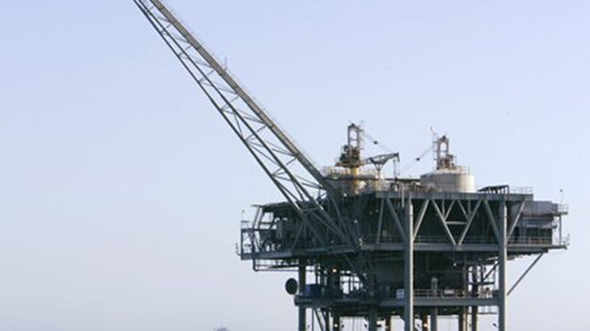 An offshore drilling rig is shown off the coast of California.