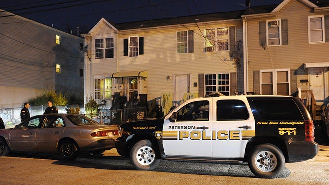 Police at the scene where a person was shot inside of a house located on Governor Street in Paterson, around 12:30 a.m. on March 24, 2016.