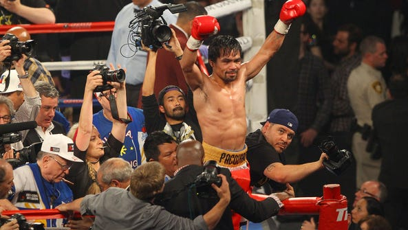Manny Pacquiao celebrates his win over Tim Bradley