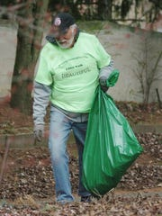Pat Strang, who lives in the Old Homestead subdivision, walked along 11 Mile picking up trash on Litter Clean-Up Day.