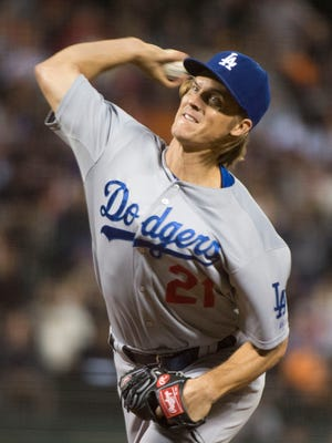 Los Angeles Dodgers starting pitcher Zack Greinke (21) delivers a pitch against the San Francisco Giants during the first inning at AT&T Park.