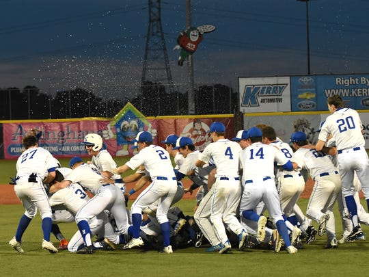 The dogpile ensues as the Highlands Bluebirds win the