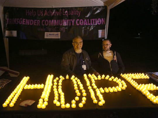 Steve Wybenga, left, and Clay Cross man a booth for the Transgender Community Coalition during the Transgender Day of Remembrance at Ruth Hardy Park in Palm Springs, Friday, November 20, 2015.