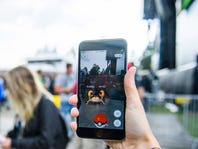 epa05427014 A woman plays Pokemon Go at the Gurten music open air festival in Bern, Switzerland, 15 July 2016. The game, that uses the GPS to locate the smartphone's location, has gained a huge popularity among smartphone users and added to the value of Nintendo that partly owns the franchise enterprise that makes Pokemon. The Gurtenfestival runs from 14 to 17 July.  EPA/MANUEL LOPEZ   EDITORIAL USE ONLY ORG XMIT: ML125
