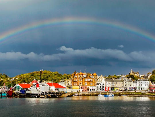 "Joy Underhill: ""This was shot in Oban, Scotland. We had just grabbed a fresh smoked-salmon sandwich when it started to rain. I turned around to find this entire rainbow. I got off about seven shots before it disappeared.""               Joy Underhill enjoys taking photos of landscapes, macros and architecture. She is an active member of the Finger Lakes Photography Guild and shoots real estate photos on the side."