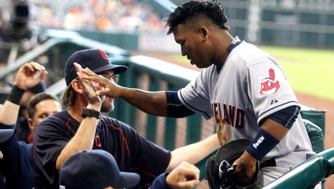 Cleveland Indians' Jose Ramirez is congratulated by teammates after hitting a home run during the fifth inning against the Houston Astros in Houston.