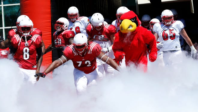 Louisville comes out onto the field before the spring game.April 16, 2016
