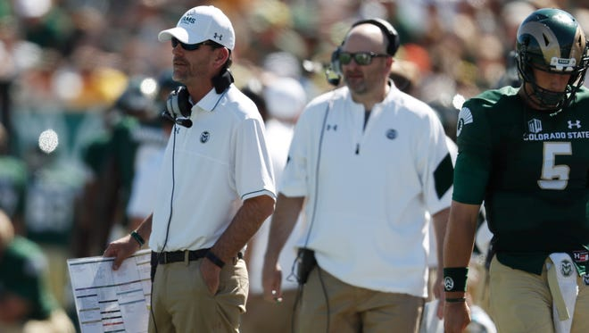 CSU coach Mike Bobo, left, and offensive coordinator Will Friend, center, will receive combined bonuses of more than $94,000 for the Rams playing in the Famous Idaho Potato Bowl.