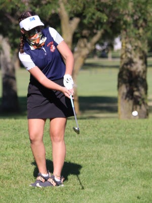 Claire Nyi, the lone senior for Pontiac's girls' golf team, follows through with a chip to the green on No. 7 at the Elks Club Thursday. It was Senior Day for the Indians and Nyi was recognized before the match. She also placed among the top four scorers for the Tribe.