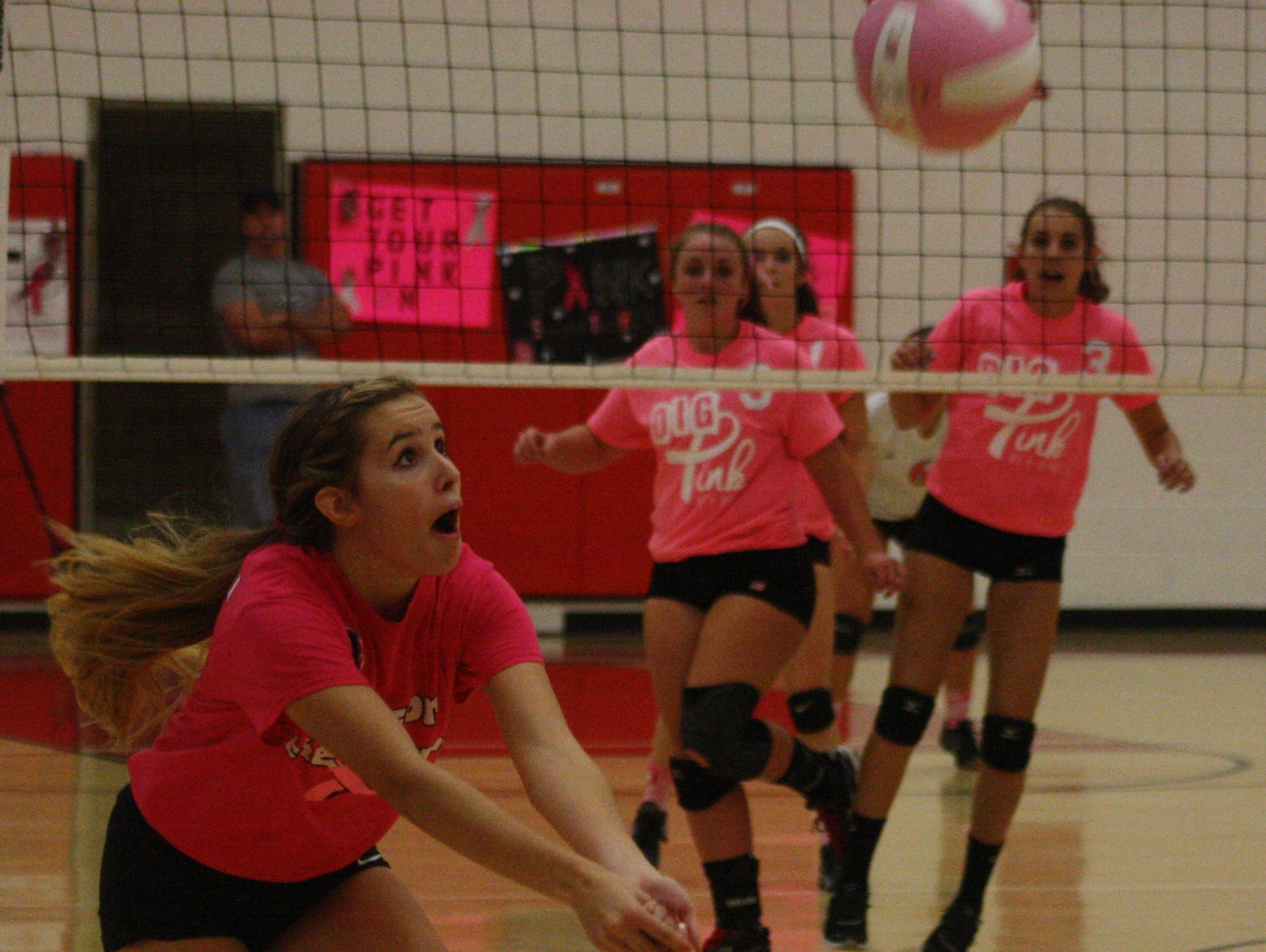 Churchill's Sam Zonca goes beyond the end line to keep this pink ball in play Tuesday night.