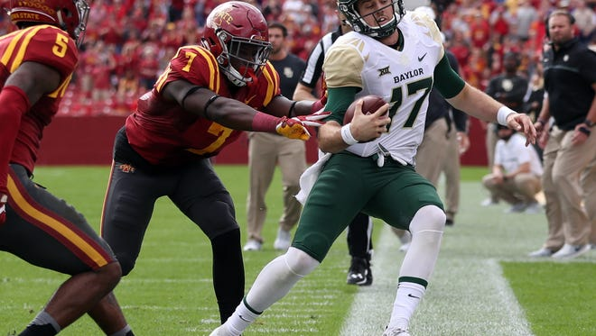 Baylor Bears quarterback Seth Russell (17) is forced out of bounds by Iowa State Cyclones linebacker Willie Harvey (7) at Jack Trice Stadium.