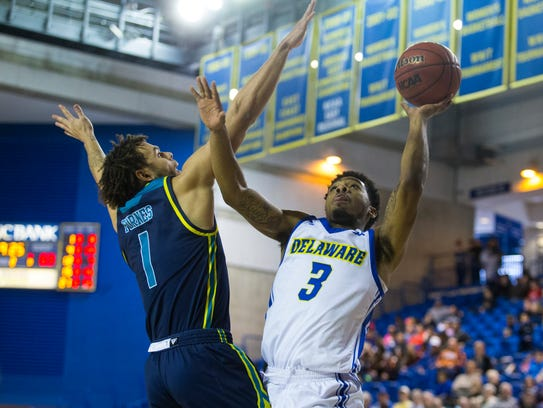 The University of Delaware's Anthony Mosley, 3, goes