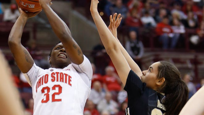 Ohio State's Shayla Cooper, left, shoots over Purdue's Dominique McBryde during the second half of an NCAA college basketball game Sunday, Jan. 17, 2016, in Columbus, Ohio. Ohio State won 90-70. (AP Photo/Jay LaPrete)