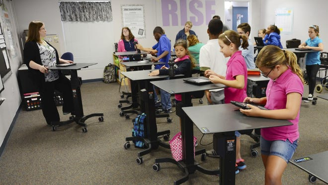 Teacher Melissa Nelson-Irving, left, of Belle Terre Elementary School  in Florida is a big booster of standup desks in the classroom.
