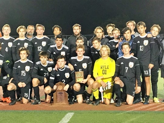Ryle poses with its state semifinal trophy during Ryle's
