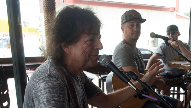 Songwriters Even Stevens, left, and  Michael Tolcher perform at the Yucatan Beach Stand on Fort Myers Beach, Oct. 5, 2014, as part of  the Island Hopper Songwriter Fest.