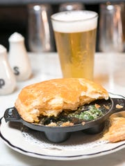Escargot de Bourgogne, bugundy snails in a puff pastry, is an appetizer at The French, 365 Fifth Ave. S., Naples.