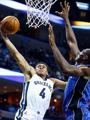 Memphis Grizzlies guard Wade Baldwin IV (left) drives the lane against the Orlando Magic defense during first quarter action at the FedExForum in Memphis, Tenn., Monday, October 2, 2017.