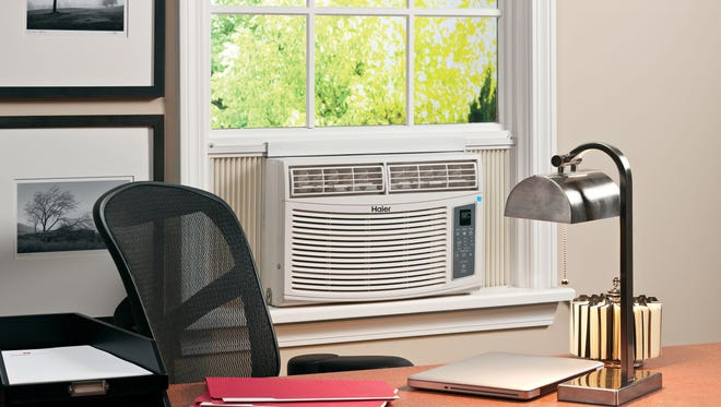 This photo shows an Energy Star qualified room air conditioner in an office setting.