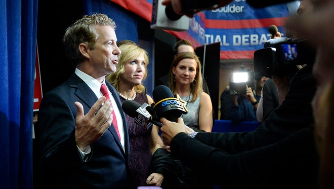 Republican presidential candidate Rand Paul speaks with members of the media after the CNBC Republican presidential debate Wednesday, Oct. 28, 2015, at the Coors Event Center on the University of Colorado campus in Boulder, Colo. (Jeremy Papasso/Daily Camera via AP) NO SALES; MANDATORY CREDIT