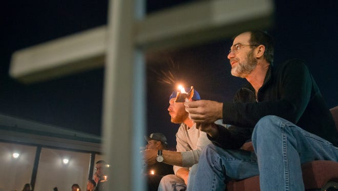 Alan Knight, right, and Blake Miller listen to speakers during the annual Homeless Candlelight Vigil held at the Waterfront Rescue Mission in Pensacola on Monday, November 14, 2016.  The event, organized by the EscaRosa Coalition on the Homeless and Waterfront Rescue Mission, commemorates National Hunger and Homelessness Awareness Week and hopes to raise awareness about homelessness in the area.