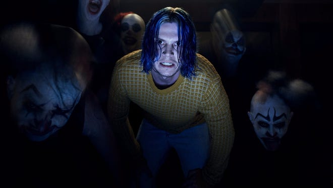Evan Peters as Kai Anderson and clowns, lots of clowns, in 'American Horror Story: Cult.'