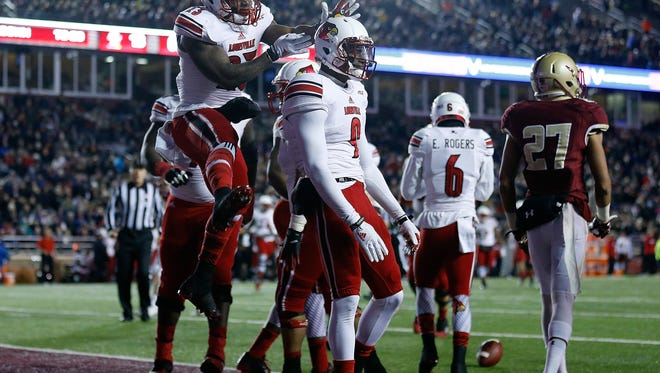 DeVante Parker #9 of the Louisville Cardinals celebrates with Brandon Radcliff #23 after he scored a touchdown against the Boston College Eagles in the second quarter at Alumni Stadium on November 8, 2014 in Chestnut Hill, Massachusetts. (Photo by Jim Rogash/Getty Images)