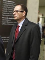 Defendant John Maggio leaves court.