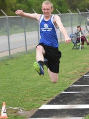 Cotter's Cameron Plumlee competes in the long jump at the Bomber Relays on Monday night.