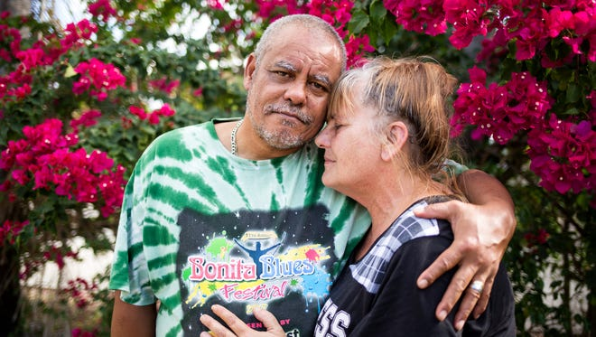 """Rodney and Lori Malone stand together for a portrait in the yard of their Bonita Springs home on Friday, Dec. 8, 2017. """"Going through the hurricane was nothing,"""" compared with what the couple has faced in the aftermath of Hurricane Irma, Rodney Malone said."""