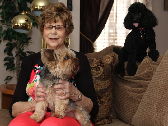 Dottie Fisher of Big Flats holds her Yorkshire terrier,