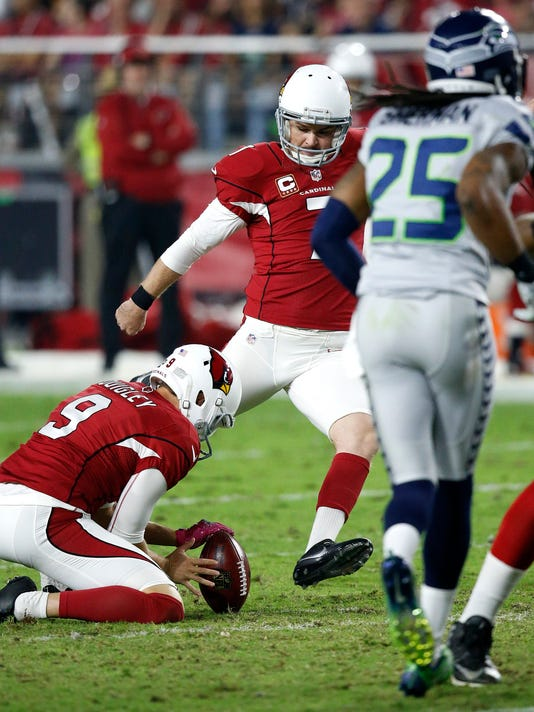 Arizona Cardinals kicker Chandler Catanzaro (7) kicks a field goal as punter Ryan Quigley (9) holds against the Seattle Seahawks during the first half of a football game, Sunday, Oct. 23, 2016, in Glendale, Ariz. (AP Photo/Ross D. Franklin)