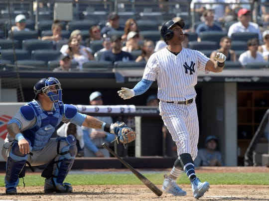 New York Yankees' Aaron Hicks, right, watches his home