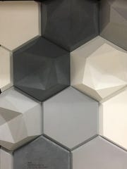 Tile is not just smooth and flat, but now three-dimensional with the use of shapes to create depth and contrast.