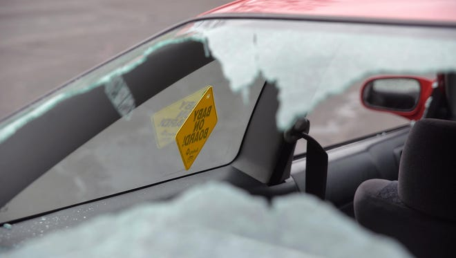 Broken glass is seen inside the car of Ashly Hannah, of Vineland, after a violent incident occured at USA Petroleum where two of her car windows were smashed, Monday, Feb. 8 in Vineland.